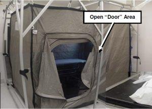 """Figure 3. Front of tent, open """"door"""" closed utilizing zipper and magnetic strips."""
