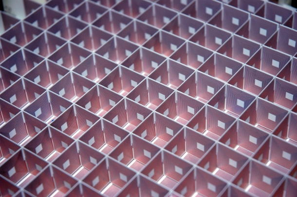 "Each side of each constituent cube of the ""superlens"" is set with a long, spiraling copper coil. The end of each coil is connected to its twin on the reverse side of the wall. (Photo: Guy Lipworth / Duke University)"