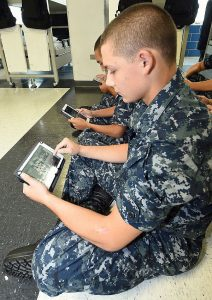 150813-N-IK959-875 GREAT LAKES, Ill., (Aug. 13, 2015) Seaman Recruit Donald Shrupp uses an electronic tablet during a study period in his barracks, USS Hopper, at Recruit Training Command (RTC). Part of the Master Chief Petty Officer of the Navy's eSailor initiative, Naval Service Training Command launched the second cycle of the pre-pilot with recruit Division 947. The second cycle of testing will help determine how well the device integrates into the training environment at RTC. The e-tablets contain RTC curriculum, including training videos, texts and access to professional development websites. (U.S. Navy photo by Scott A. Thornbloom/Released)